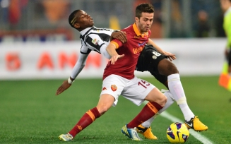 AS Roma Bosnian midfielder Miralem Pjanic (front) fights for the ball with Juventus' French midfielder Paul Pogba during the Italian Serie A football match between AS Roma and Juventus on February 16, 2013 at the Olympic Stadium in Rome. AFP PHOTO / GIUSEPPE CACACE (Photo credit should read GIUSEPPE CACACE/AFP/Getty Images)